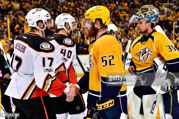 Ryan Kesler of the Anaheim Ducks shakes hands with Matt Irwin of the Nashville Predators after the Predators defeated the Ducks 6 to 3 in Game Six of...