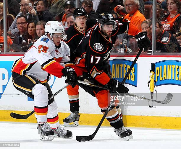 Ryan Kesler of the Anaheim Ducks skates against Sean Monahan of the Calgary Flames in Game Five of the Western Conference Semifinals during the 2015...