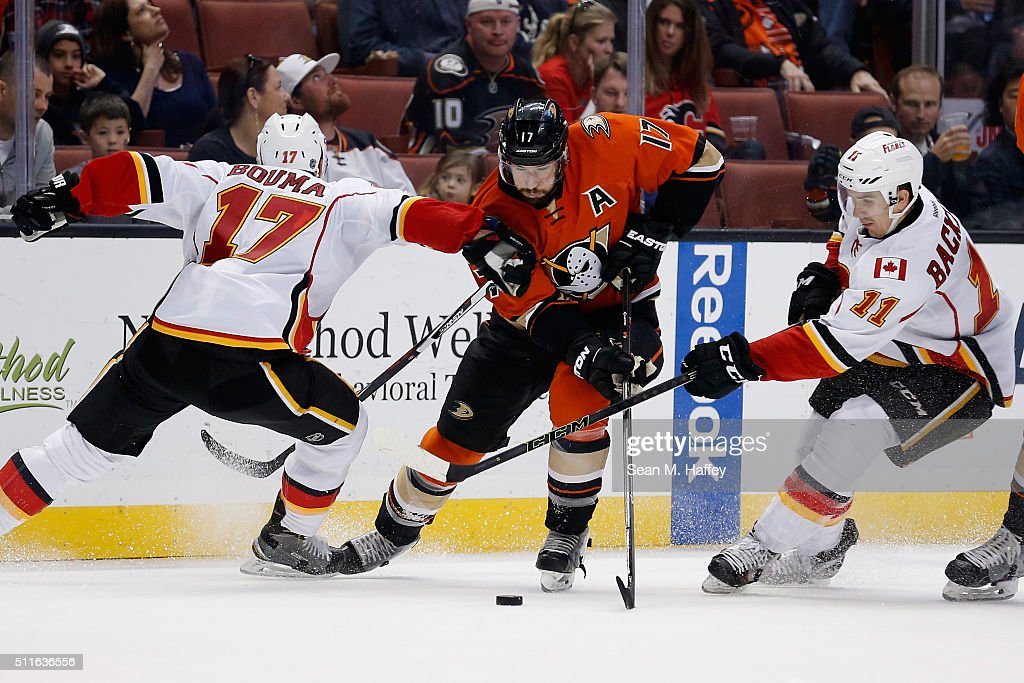 Ryan Kesler #17 of the Anaheim Ducks splits the defense of Mikael Backlund #11 and Lance Bouma #17 of the Calgary Flames during a game at Honda Center on February 21, 2016 in Anaheim, California.