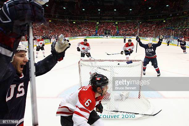Ryan Kesler of the United States celebrates after scoring a goal on the deflection past Roberto Luongo of Canada during the ice hockey men's gold...