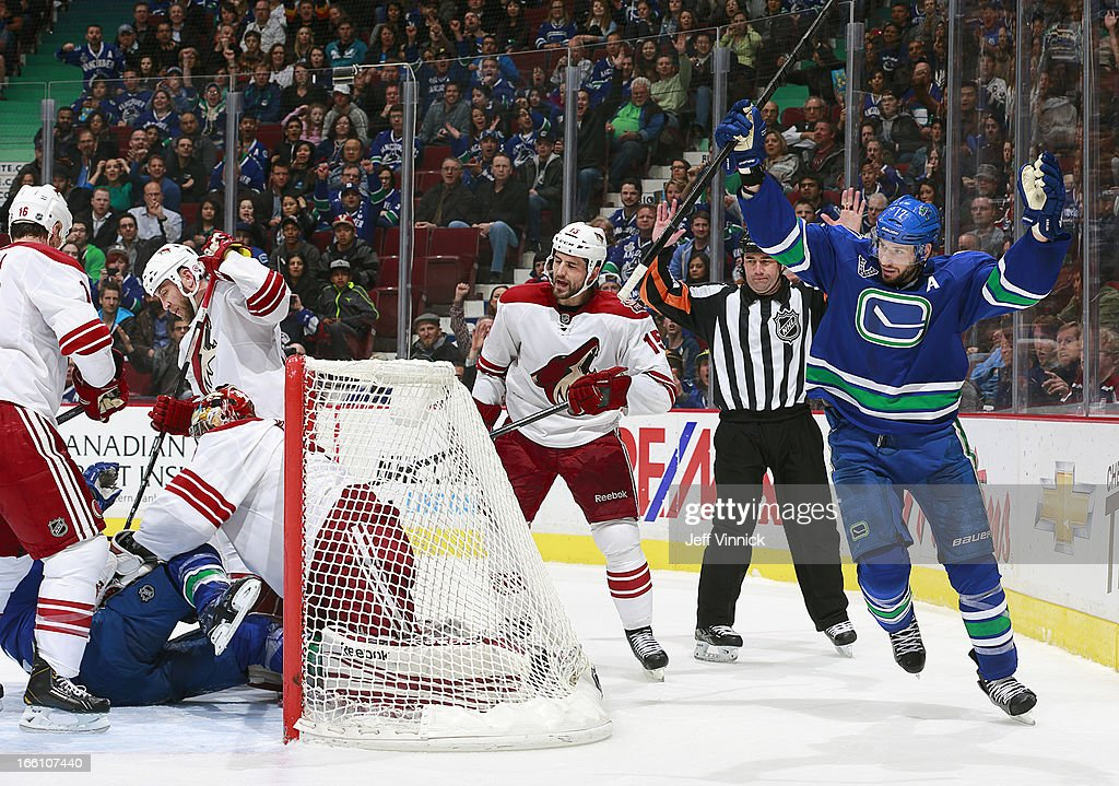 Ryan Kesler #17 of the Vancouver Canucks and Boyd Gordon #15 of the Phoenix Coyotes react to a goal that was disallowed as Mike Smith #41 of the Coyotes falls on Alexandre Burrows #14 of the Canucks during their NHL game at Rogers Arena April 8, 2013 in Vancouver, British Columbia, Canada.