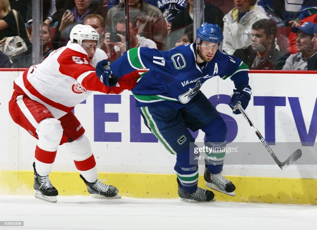 Ryan Kesler of the Vancouver Canucks and Valtteri Filppula of the Detroit Red Wings battle along the boards during their game at General Motors Place...