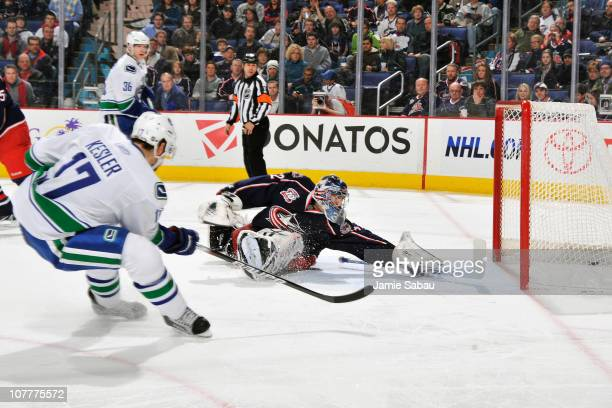 Ryan Kesler of the Vancouver Canucks beats goaltender Mathieu Garon of the Columbus Blue Jackets to score during the second period on December 23...