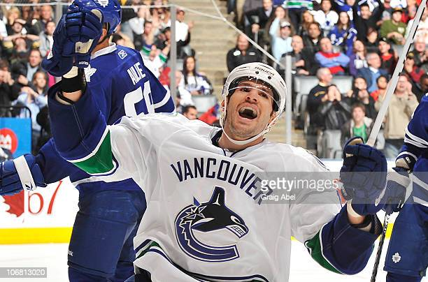 Ryan Kesler of the Vancouver Canucks celebrates a third period goal against the Toronto Maple Leafs during game action November 13 2010 at the Air...