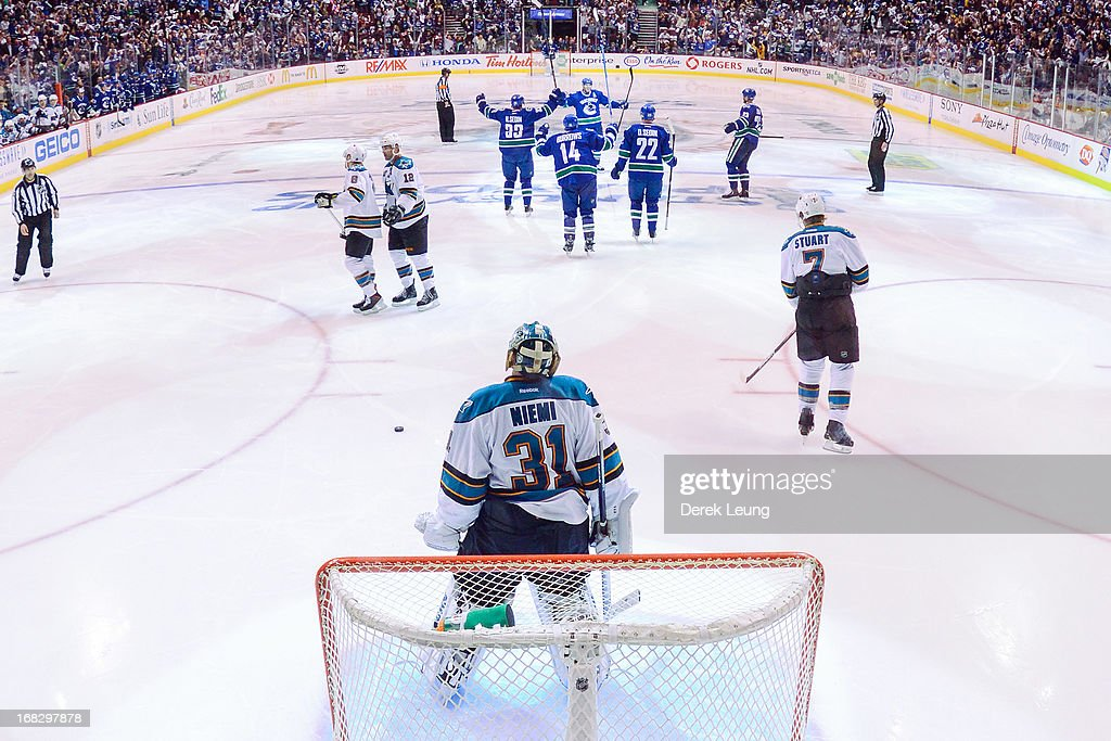 Ryan Kesler #17 of the Vancouver Canucks celebrates his goal with teammates Henrik Sedin #33, Daniel Sedin #22, Alex Burrows #14, and Alexander Edler #23 while a dejected Antti Niemi #31 of the San Jose Sharks looks on in Game Two of the Western Conference Quarterfinals during the 2013 NHL Stanley Cup Playoffs at Rogers Arena on May 3, 2013 in Vancouver, British Columbia, Canada.