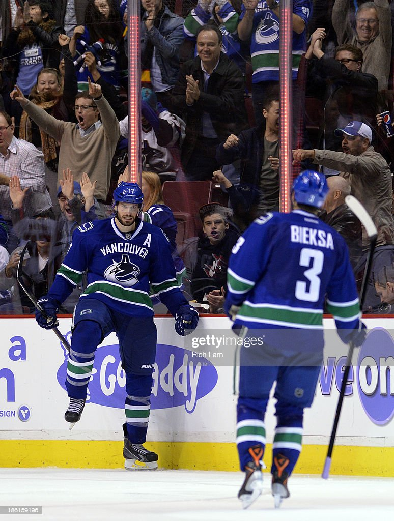 <a gi-track='captionPersonalityLinkClicked' href=/galleries/search?phrase=Ryan+Kesler&family=editorial&specificpeople=206915 ng-click='$event.stopPropagation()'>Ryan Kesler</a> #17 of the Vancouver Canucks celebrates with <a gi-track='captionPersonalityLinkClicked' href=/galleries/search?phrase=Kevin+Bieksa&family=editorial&specificpeople=688792 ng-click='$event.stopPropagation()'>Kevin Bieksa</a> #3 after scoring against the Washington Capitals during the second period in NHL action on October 28, 2012 at Rogers Arena in Vancouver, British Columbia, Canada.