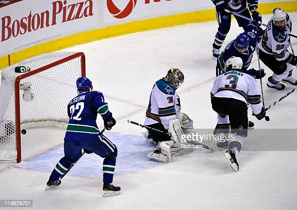 Ryan Kesler of the Vancouver Canucks deflects the puck into the net for a goal to tie the game at 22 with less than 14 seconds left in the third...