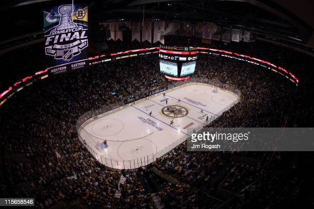 Ryan Kesler of the Vancouver Canucks faces off against Patrice Bergeron of the Boston Bruins to start Game Four of the 2011 NHL Stanley Cup Final at...
