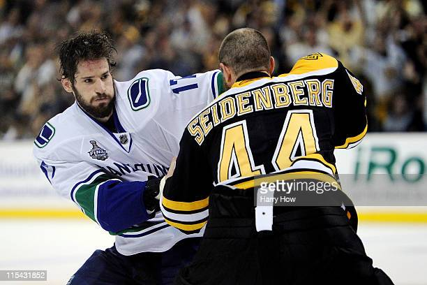 Ryan Kesler of the Vancouver Canucks fights with Dennis Seidenberg of the Boston Bruins during Game Three of the 2011 NHL Stanley Cup Final at TD...