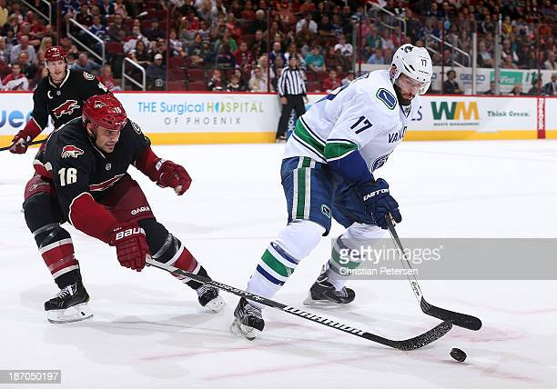 Ryan Kesler of the Vancouver Canucks handles the puck under presure from Rostislav Klesla of the Phoenix Coyotes during the second period of the NHL...
