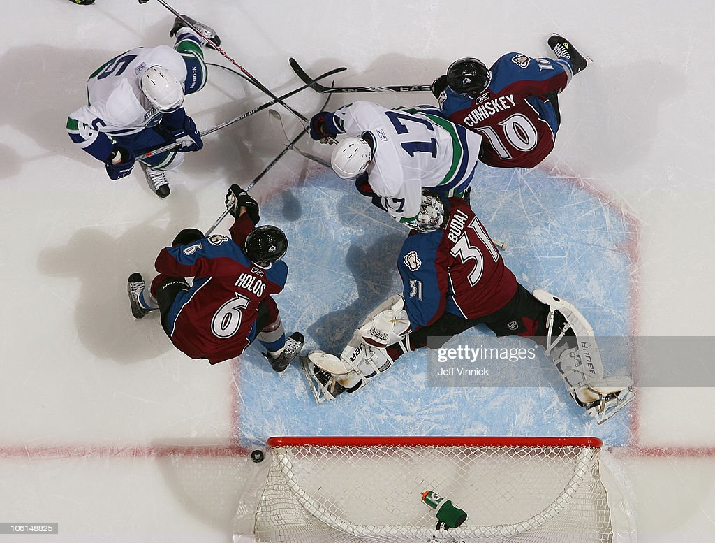 <a gi-track='captionPersonalityLinkClicked' href=/galleries/search?phrase=Ryan+Kesler&family=editorial&specificpeople=206915 ng-click='$event.stopPropagation()'>Ryan Kesler</a> #17 of the Vancouver Canucks hits the post after taking a shot on <a gi-track='captionPersonalityLinkClicked' href=/galleries/search?phrase=Peter+Budaj&family=editorial&specificpeople=228123 ng-click='$event.stopPropagation()'>Peter Budaj</a> #31 of the Colorado Avalanche at Rogers Arena on October 26, 2010 in Vancouver, British Columbia, Canada. Vancouver won 4-3 in overtime.