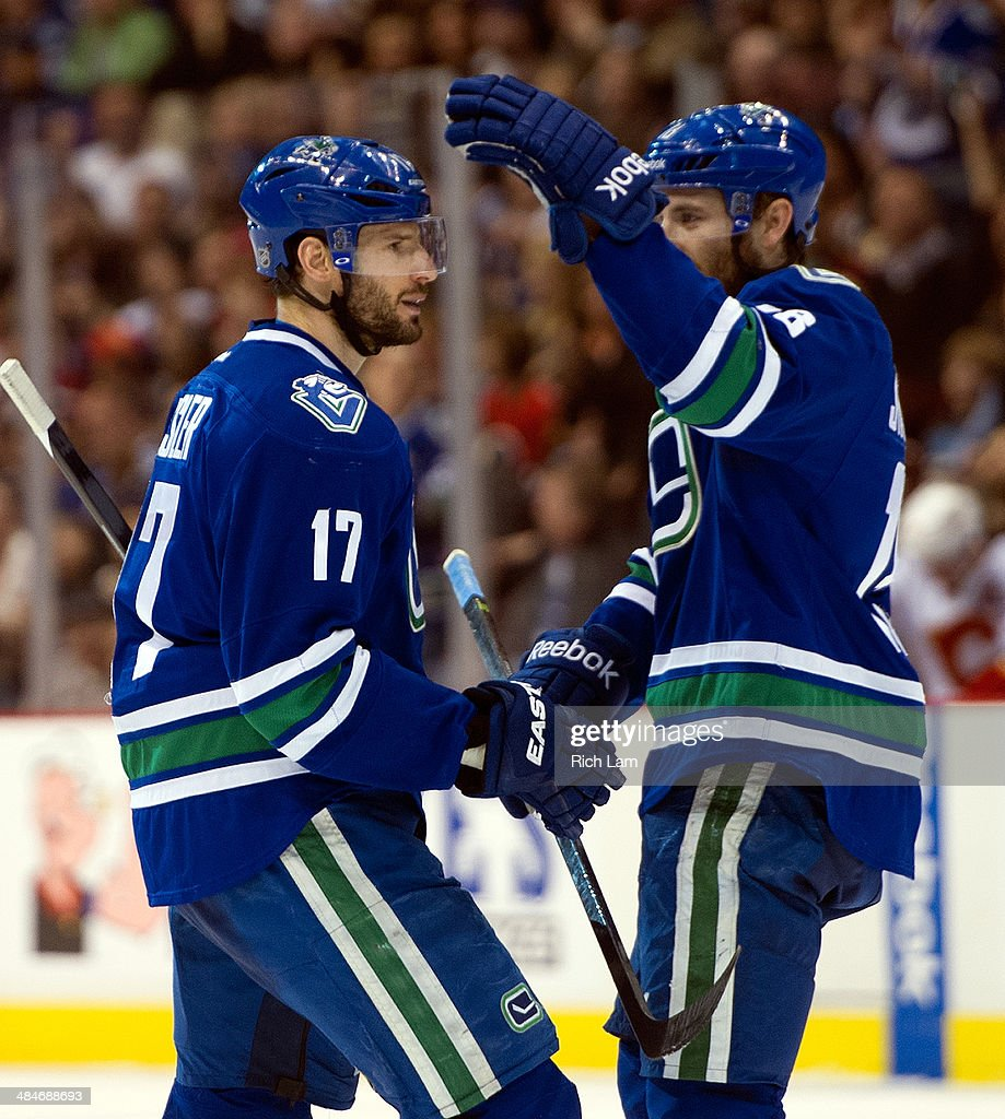 Ryan Kesler #17 of the Vancouver Canucks is congratulated by Ryan Stanton #18 after scoring a goal against the Calgary Flames during the second period in NHL action on April 13, 2014 at Rogers Arena in Vancouver, British Columbia, Canada.