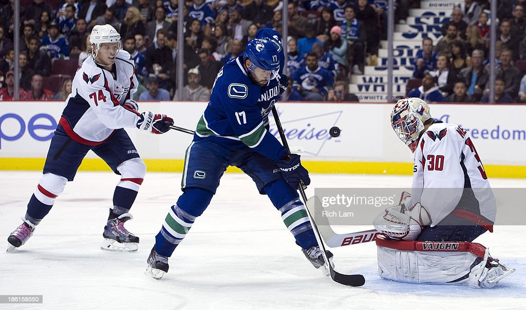 <a gi-track='captionPersonalityLinkClicked' href=/galleries/search?phrase=Ryan+Kesler&family=editorial&specificpeople=206915 ng-click='$event.stopPropagation()'>Ryan Kesler</a> #17 of the Vancouver Canucks is stopped by goalie <a gi-track='captionPersonalityLinkClicked' href=/galleries/search?phrase=Michal+Neuvirth&family=editorial&specificpeople=3205600 ng-click='$event.stopPropagation()'>Michal Neuvirth</a> #30 of the Washington Capitals during the second period in NHL action on October 28, 2013 at Rogers Arena in Vancouver, British Columbia, Canada. John Carlson #74 of the Washington Capitals tries to help defend on the play.