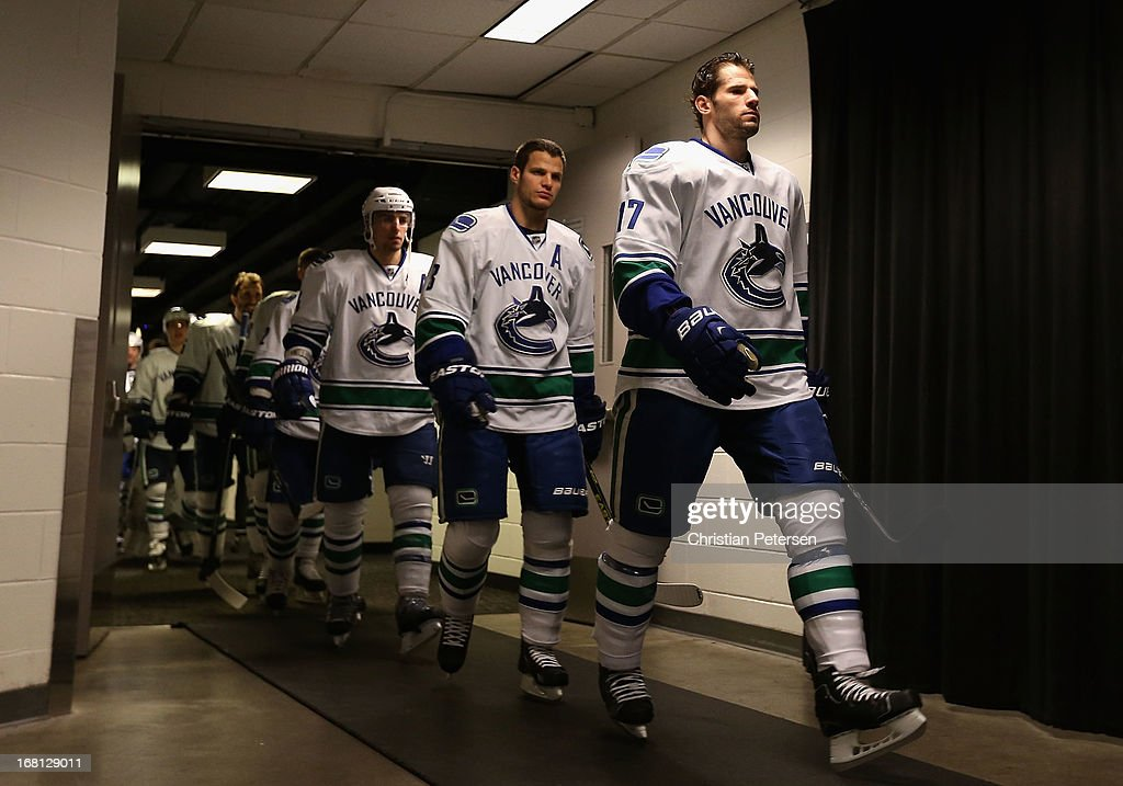 Ryan Kesler #17 (R) of the Vancouver Canucks leads teammates out onto the ice before Game Three of the Western Conference Quarterfinals against the San Jose Sharks during the 2013 NHL Stanley Cup Playoffs at HP Pavilion on May 5, 2013 in San Jose, California.