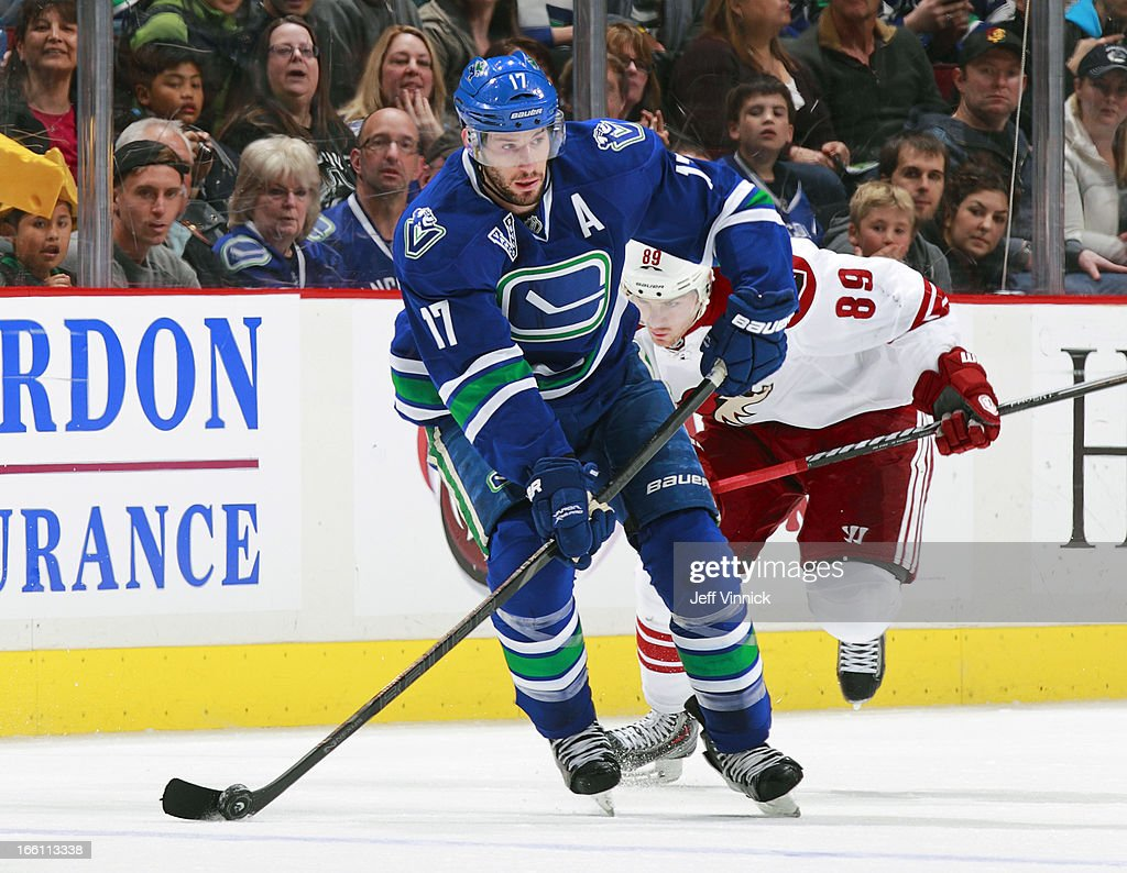 <a gi-track='captionPersonalityLinkClicked' href=/galleries/search?phrase=Ryan+Kesler&family=editorial&specificpeople=206915 ng-click='$event.stopPropagation()'>Ryan Kesler</a> #17 of the Vancouver Canucks pulls away from <a gi-track='captionPersonalityLinkClicked' href=/galleries/search?phrase=Mikkel+Boedker&family=editorial&specificpeople=4697252 ng-click='$event.stopPropagation()'>Mikkel Boedker</a> #89 of the Phoenix Coyotes during an NHL game at Rogers Arena April 8, 2013 in Vancouver, British Columbia, Canada. Vancouver won 2-0.