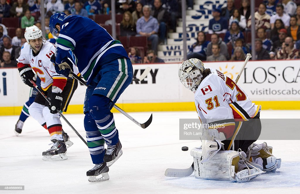 Ryan Kesler #17 of the Vancouver Canucks redirects a shot on goalie Karri Ramo #31 of the Calgary Flames during the second period in NHL action on April 13, 2014 at Rogers Arena in Vancouver, British Columbia, Canada.