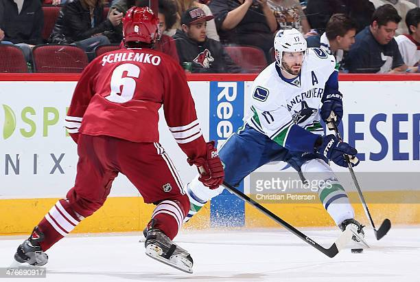 Ryan Kesler of the Vancouver Canucks skates with the puck against David Schlemko of the Phoenix Coyotes during the second period of the NHL game at...