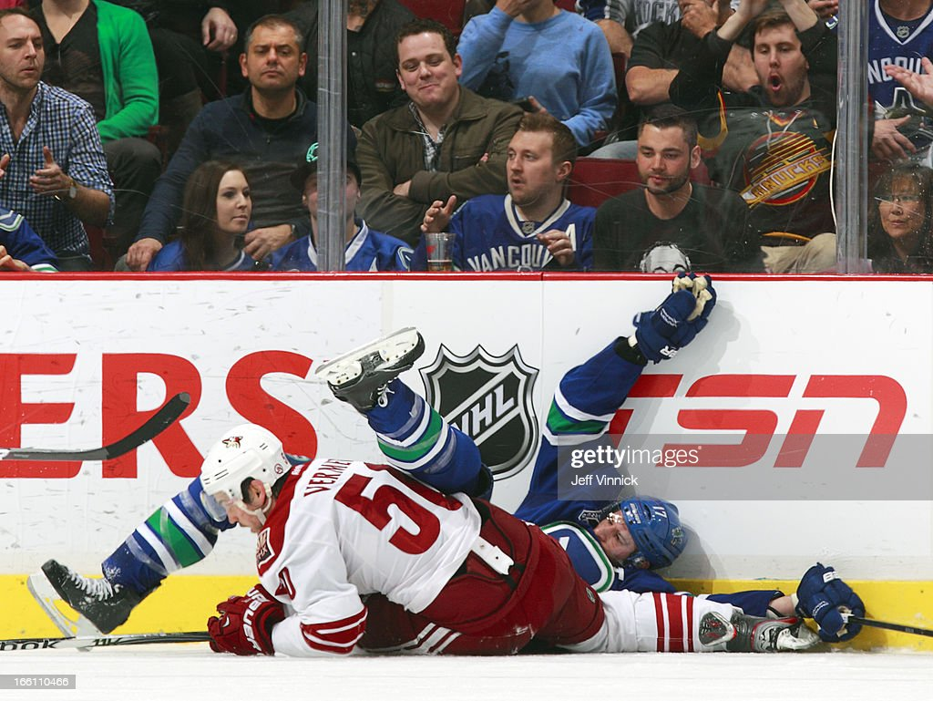 <a gi-track='captionPersonalityLinkClicked' href=/galleries/search?phrase=Ryan+Kesler&family=editorial&specificpeople=206915 ng-click='$event.stopPropagation()'>Ryan Kesler</a> #17 of the Vancouver Canucks was penalized for this hit on <a gi-track='captionPersonalityLinkClicked' href=/galleries/search?phrase=Antoine+Vermette&family=editorial&specificpeople=206302 ng-click='$event.stopPropagation()'>Antoine Vermette</a> #50 of the Phoenix Coyotes during an NHL game at Rogers Arena April 8, 2013 in Vancouver, British Columbia, Canada. Vancouver won 2-0.