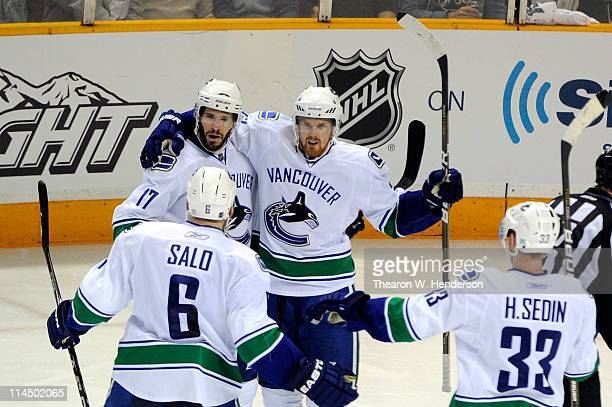 Ryan Kesler Sami Salo Daniel Sedin and Henrik Sedin of the Vancouver Canucks celebrate Kesler's second period goal in Game Four of the Western...