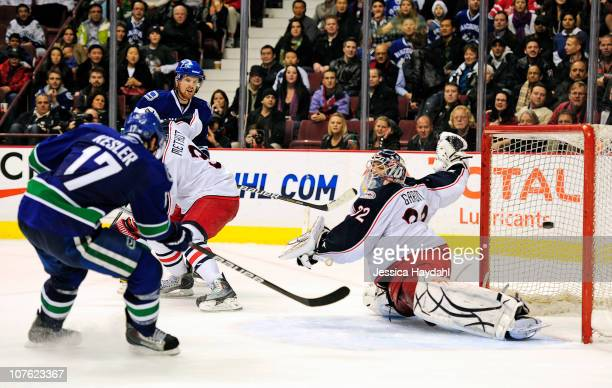 Ryan Kesler scores the overtime winning goal on Mathieu Garon of the Columbus Blue Jackets during their game at Rogers Arena on December 15 2010 in...
