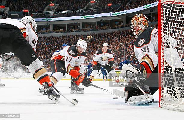 Ryan Kesler sweeps the puck away from the slot in front of Frederik Andersen of the Anaheim Ducks during their NHL game at Rogers Arena January 27...
