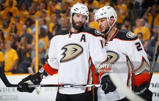 Ryan Kesler talks with Kevin Bieksa of the Anaheim Ducks before a face off against the Nashville Predators in Game Four of the Western Conference...