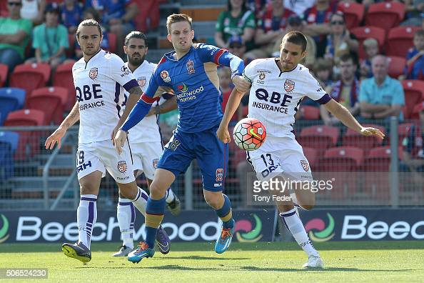 Ryan Kitto of the Jets contests the ball with Diogo Ferreira of the Glory during the round 16 ALeague match between the Newcastle Jets and the Perth...
