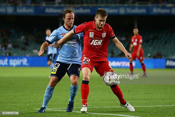 Ryan Kitto of United is challenged by Rhyan Grant of Sydney FC during the round eight ALeague match between Sydney FC and Adelaide United at Allianz...