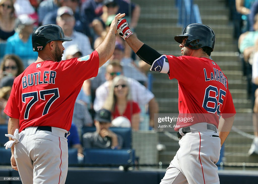 Ryan LaMarre of the Boston Red Sox celebrates with Dan Butler after hitting a two run home run in the eighth inning during the game against the New...