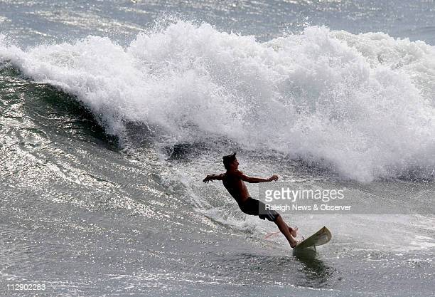 Ryan Lankford of Greenville jumps off the end of the Oceanana Fishing Pier at Atlantic Beach located on North Carolina's Crystal Coast Most surfers...