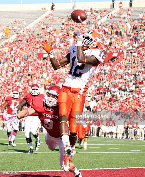 Ryan Lankford of the Illinois Illini reaches up for a pass while tackled by Greg Heban of the Indiana Hoosiers during the game at Memorial Stadium on...