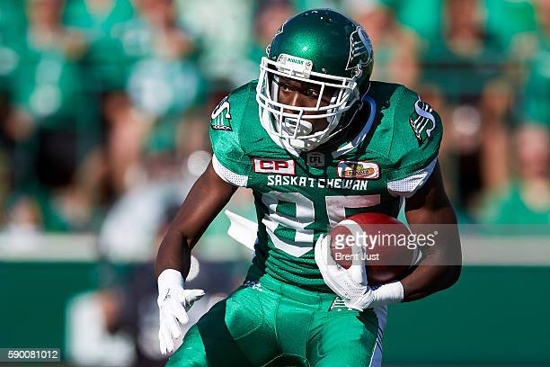 Ryan Lankford of the Saskatchewan Roughriders carries the ball during the game between the Calgary Stampeders and Saskatchewan Roughriders at Mosaic...