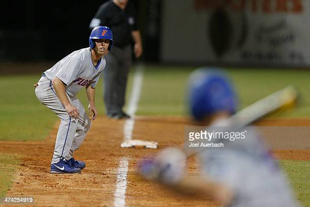 Ryan Larson of the Florida Gators prepares to run towards home plate against the Miami Hurricanes during seventh inning action on February 21 2014 at...