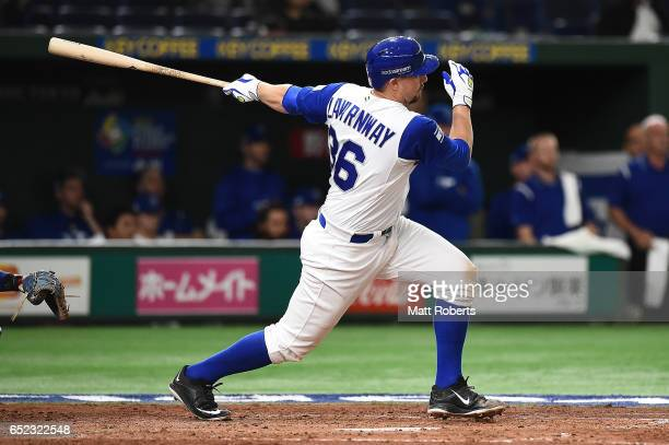 Ryan Lavarnway of Israel hits a RBI double grounder to left field scoring Ike Davis in the fourth inning during the World Baseball Classic Pool E...