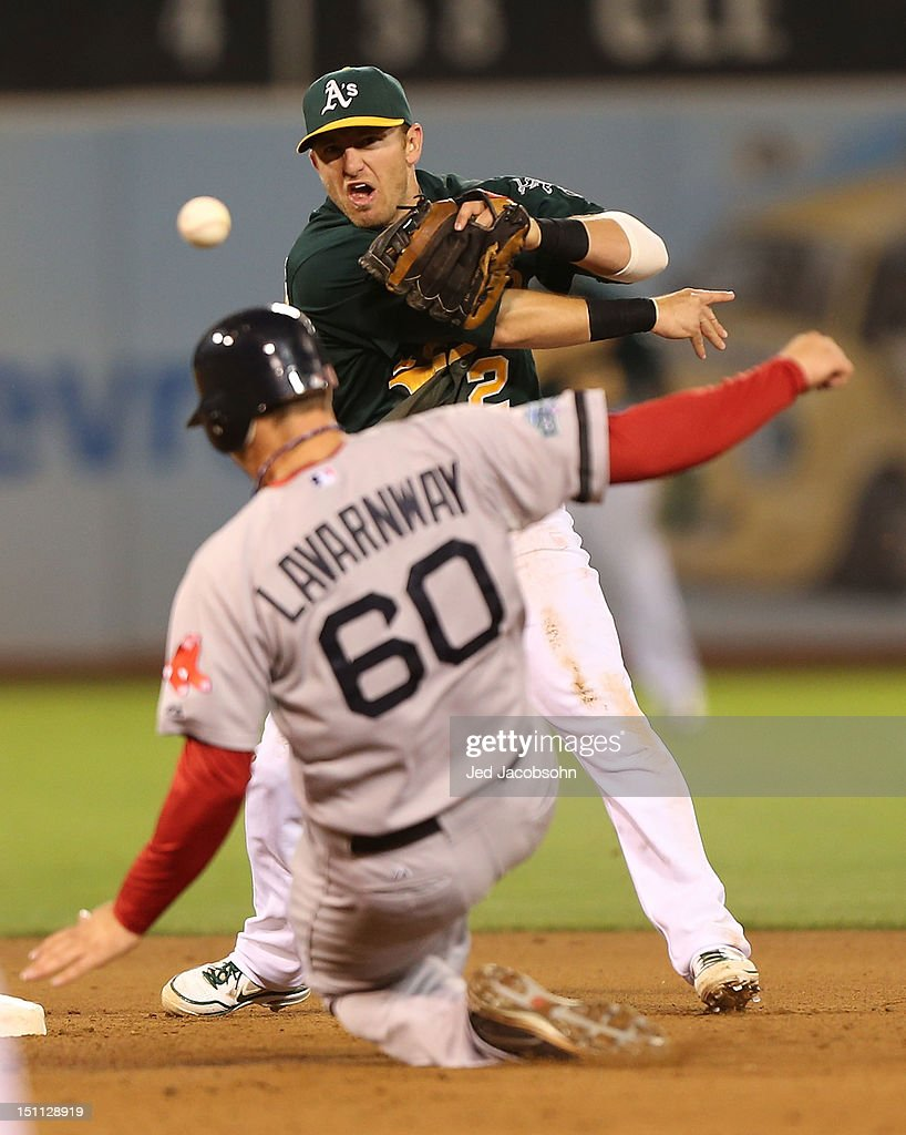 Ryan Lavarnway #60 of the Boston Red Sox slides into second on a fielder's choice hit by Pedro Ciriaco as Cliff Pennington #2 of the Oakland Athletics throws to first during a Major League Baseball game at the O.co Coliseum on September 1, 2012 in Oakland, California.