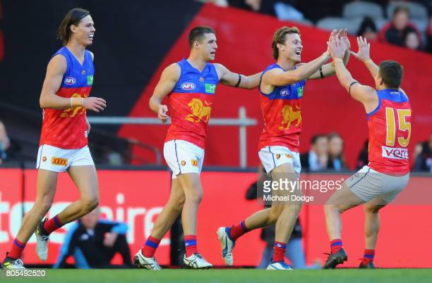 Ryan Lester of the Lions celebrates a goal in the dying stages with Dayne Zorko during the round 15 AFL match between the Essendon Bombers and the...