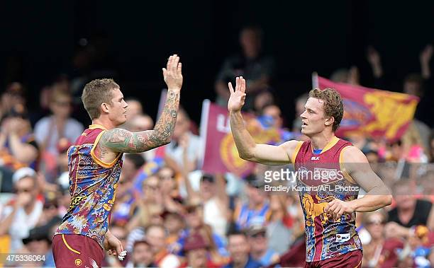 Ryan Lester of the Lions celebrates with team mate Dayne Beams after kicking a goal during the round nine AFL match between the Brisbane Lions and...