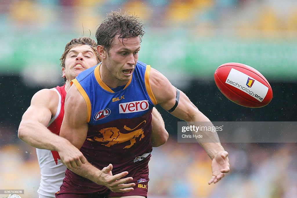 Ryan Lester of the Lions is tackled by Dane Rampe of the Swans during the round six AFL match between the Brisbane Lions and the Sydney Swans at The Gabba on May 1, 2016 in Brisbane, Australia.