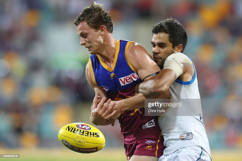 Ryan Lester of the Lions is tackled by Jack Martin of the Suns during the round 21 AFL match between the Brisbane Lions and the Gold Coast Suns at The Gabba on August 12, 2017 in Brisbane, Australia.