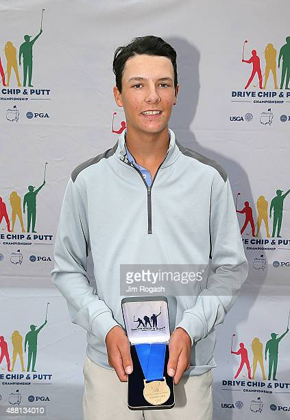 Ryan Levy holds his first place medal for chipping during the in the Boys 1415 Chipping Competition during the Drive Chip and Putt Championship at...