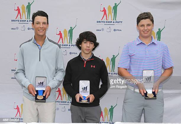 Ryan Levy placed second Zane Monaghan placed first and Jack Wall placed third in the Boys 1415 putting competition as they pose with their medal...
