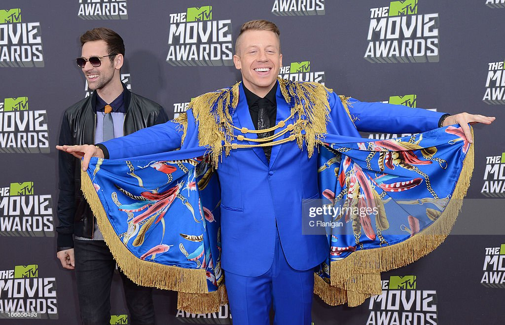 Ryan Lewis and Macklemore arrive at the 2013 MTV Movie Awards at Sony Pictures Studios on April 14, 2013 in Culver City, California.