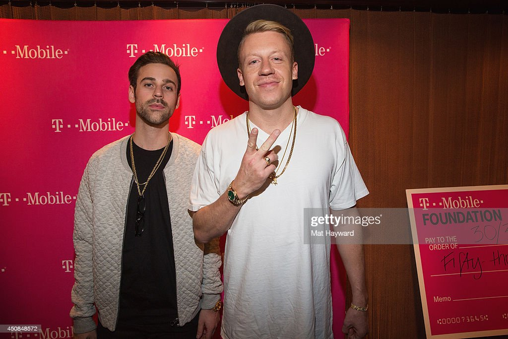 Ryan Lewis (L) and <a gi-track='captionPersonalityLinkClicked' href=/galleries/search?phrase=Macklemore&family=editorial&specificpeople=7639427 ng-click='$event.stopPropagation()'>Macklemore</a> of <a gi-track='captionPersonalityLinkClicked' href=/galleries/search?phrase=Macklemore&family=editorial&specificpeople=7639427 ng-click='$event.stopPropagation()'>Macklemore</a> and Ryan Lewis pose for a photo backstage as T-Mobile Un-leashes Music Freedom at Paramount Theatre on June 18, 2014 in Seattle, Washington.