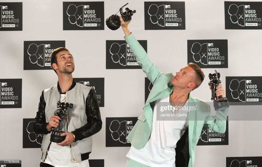 Ryan Lewis and <a gi-track='captionPersonalityLinkClicked' href=/galleries/search?phrase=Macklemore&family=editorial&specificpeople=7639427 ng-click='$event.stopPropagation()'>Macklemore</a> pose in the press room with the Best Hip Hop Video and Best Cinematography awards the 2013 MTV Video Music Awards at the Barclays Center on August 25, 2013 in the Brooklyn borough of New York City.