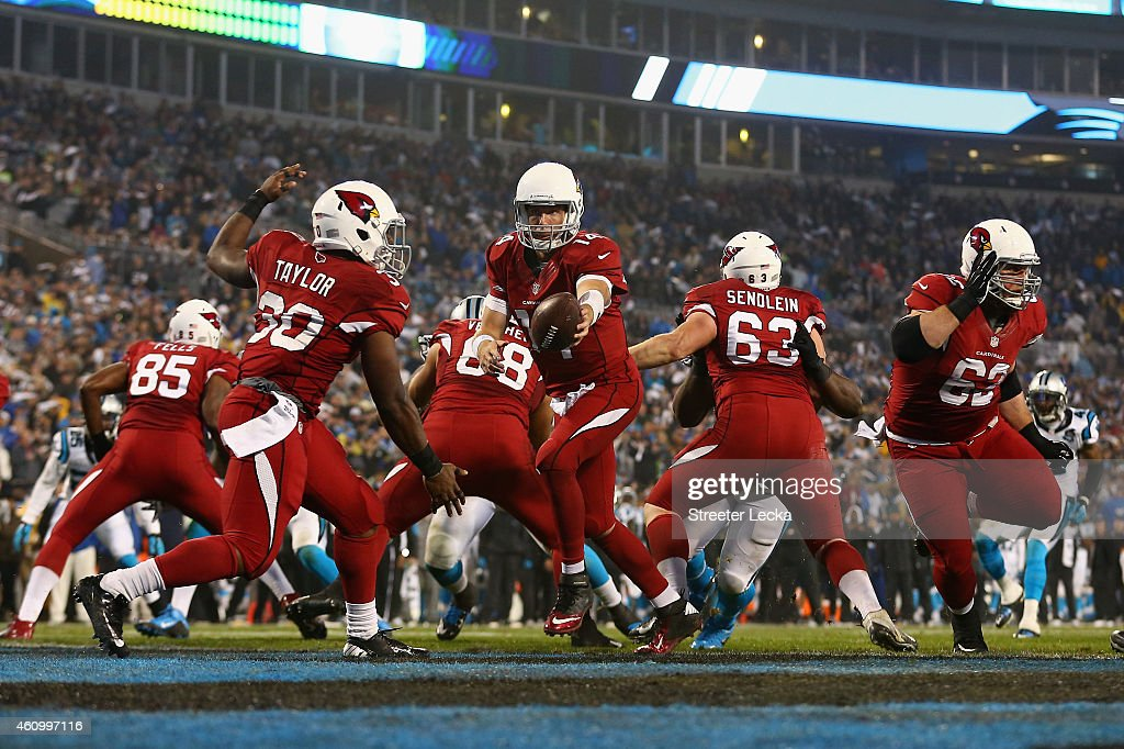 Ryan Lindley #14 of the Arizona Cardinals fakes the hand off to Stepfan Taylor #30 out of their own endzone in the 2nd quarter against the Carolina Panthers during their NFC Wild Card Playoff game at Bank of America Stadium on January 3, 2015 in Charlotte, North Carolina.