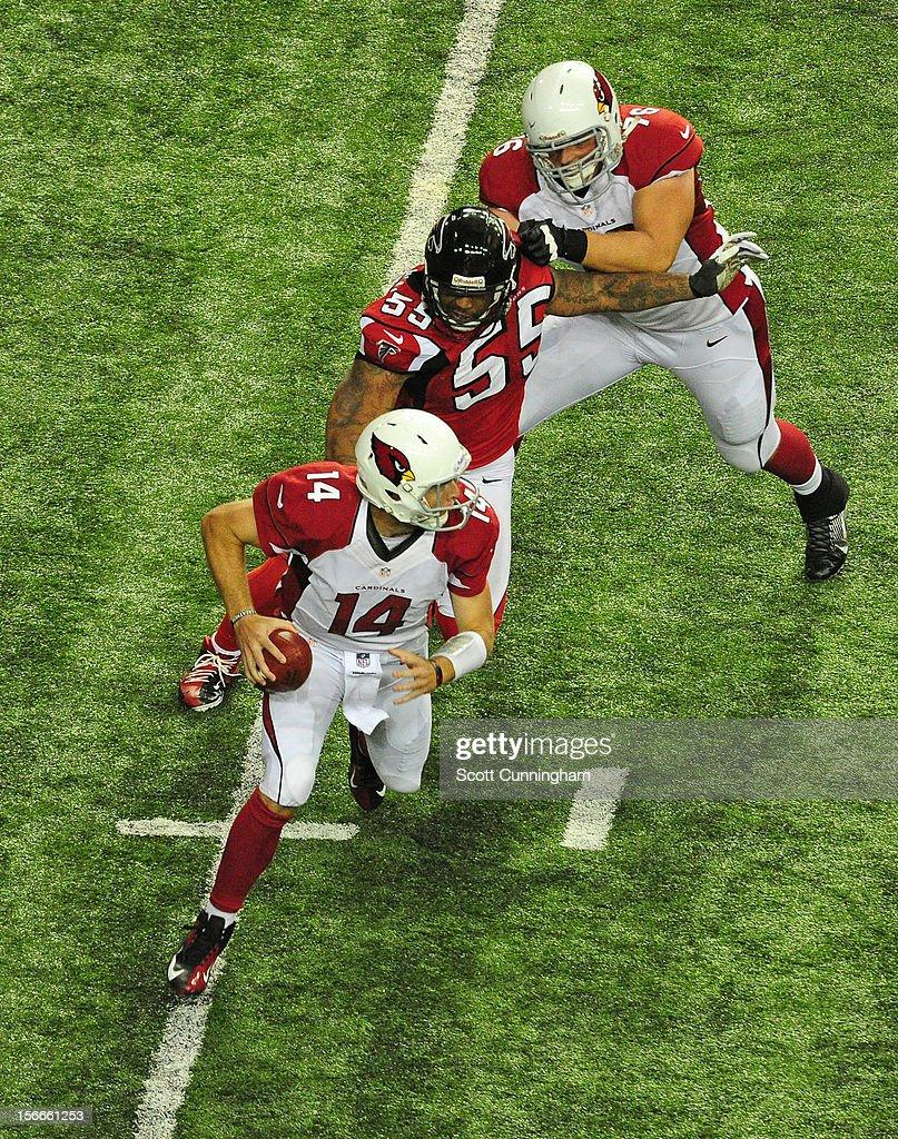 Ryan Lindley #14 of the Arizona Cardinals is pursued by John Abraham #55 of the Atlanta Falcons at the Georgia Dome on November 18, 2012 in Atlanta, Georgia