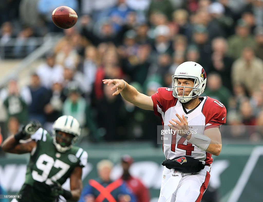 <a gi-track='captionPersonalityLinkClicked' href=/galleries/search?phrase=Ryan+Lindley&family=editorial&specificpeople=6235431 ng-click='$event.stopPropagation()'>Ryan Lindley</a> #14 of the Arizona Cardinals passes the ball as <a gi-track='captionPersonalityLinkClicked' href=/galleries/search?phrase=Calvin+Pace&family=editorial&specificpeople=773024 ng-click='$event.stopPropagation()'>Calvin Pace</a> #97 of the New York Jets defends on December 2, 2012 at MetLife Stadium in East Rutherford, New Jersey. The New York Jets defeated the Arizona Cardinals 7-6.