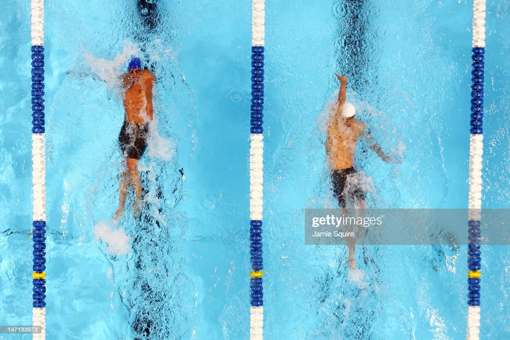 Ryan Lochte and Michael Phelps compete in the championship final heat of the Men's 400 m Individual Medely during the 2012 U.S. Olympic Swimming Team Trials at CenturyLink Center on June 25, 2012 in Omaha, Nebraska.