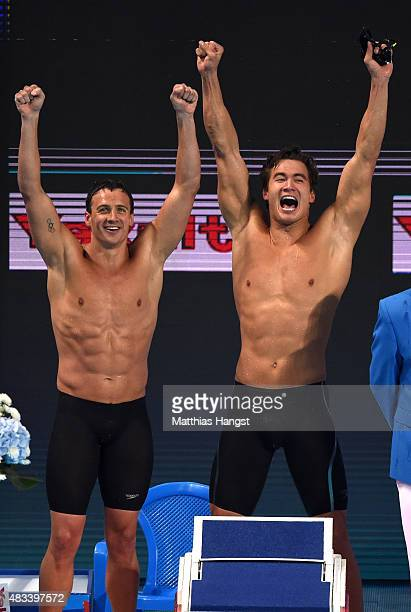 Ryan Lochte and Nathan Adrian of the United States celebrate winning the gold medal in a new world record time of 32305 in the Mixed 4x100m Freestyle...