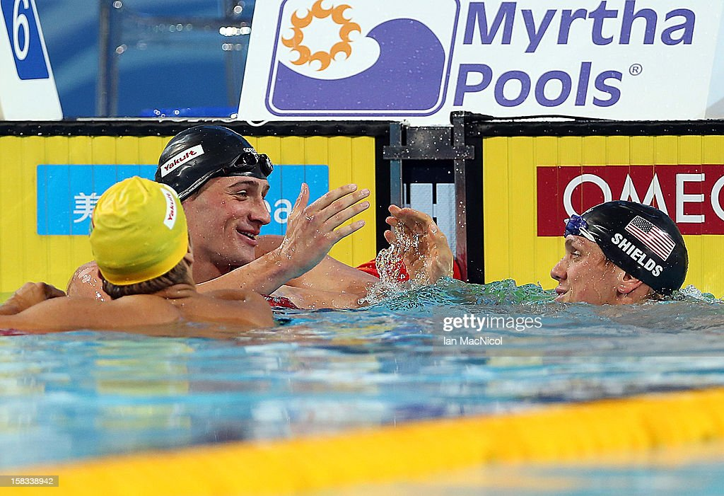Ryan Lochte and Thomas Shields both of USA react at the end of the Men's 100m Butterfly final during day two of the FINA World Short Course Swimming Championships on December 13, 2012 in Istanbul, Turkey.